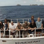 The expedition team with the Chanter Islands in the background.